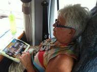 Lyn playing word games on iPad.