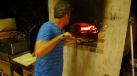 Paul cooking the pizzas